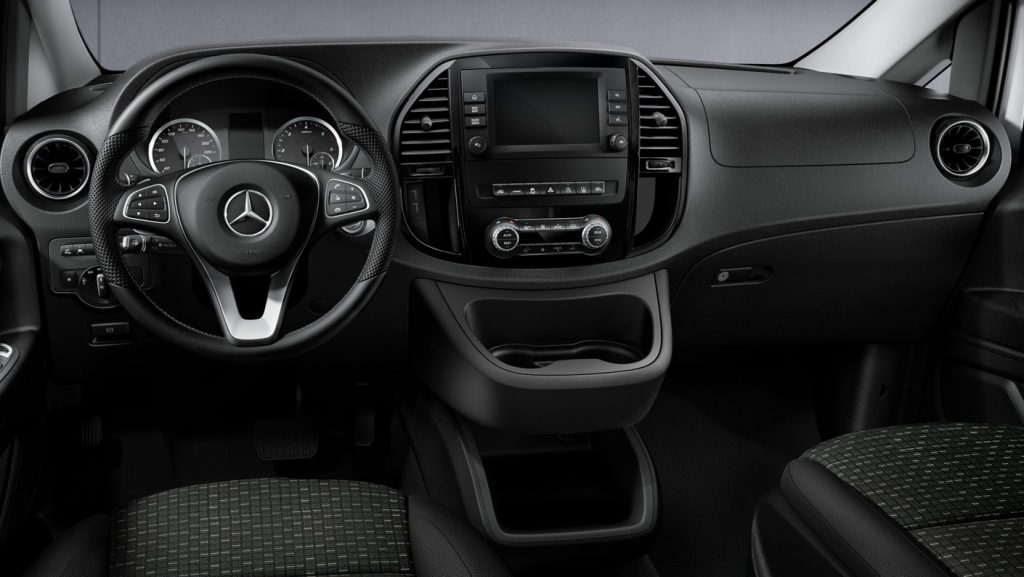 The interior dash view of the 2021 Mercedes-Benz Metris with the three-pointed star on the steering wheel.
