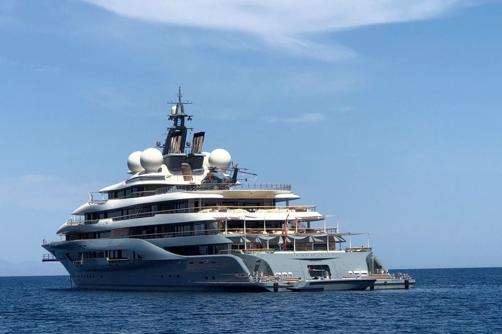 A large Yacht in the middle of the ocean.
