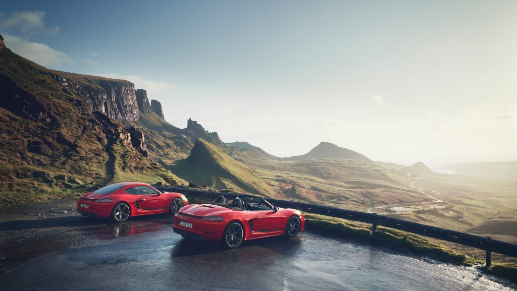 Stuttgart's red 718 Boxster and Cayman models looking out over a valley