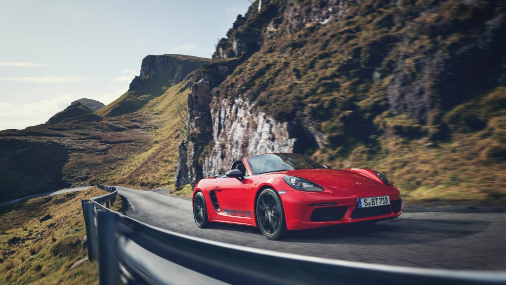 The red 718 Boxster on a twisty cliffside road