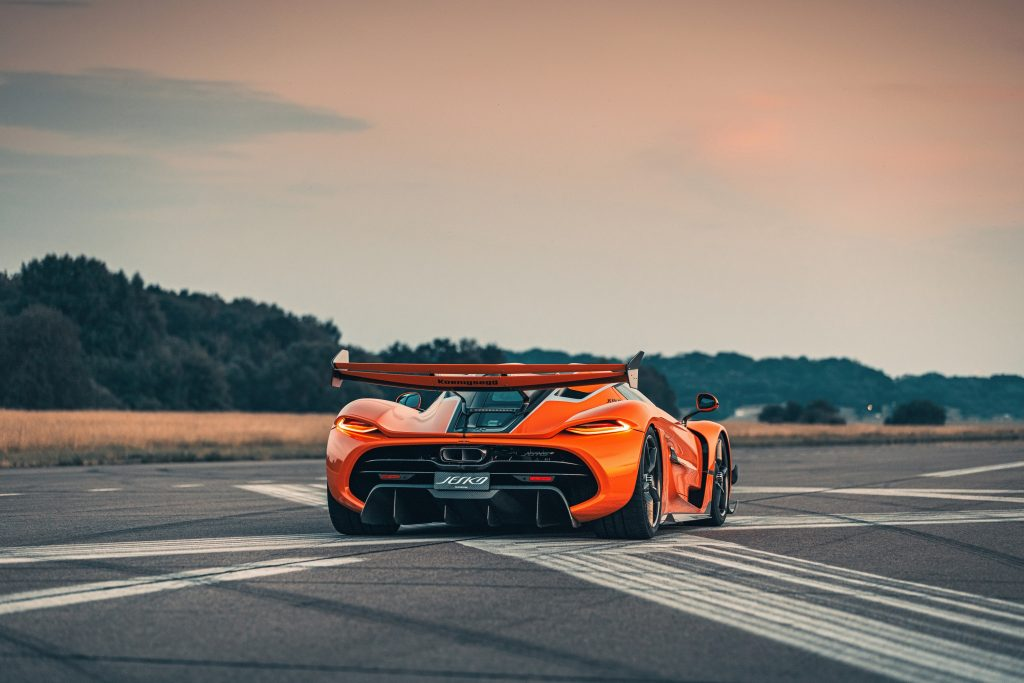 The rear of an orange Jesko, with larger-than-life wing