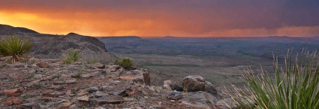 the desert landscape surrounding Marfa, Texas at sunset