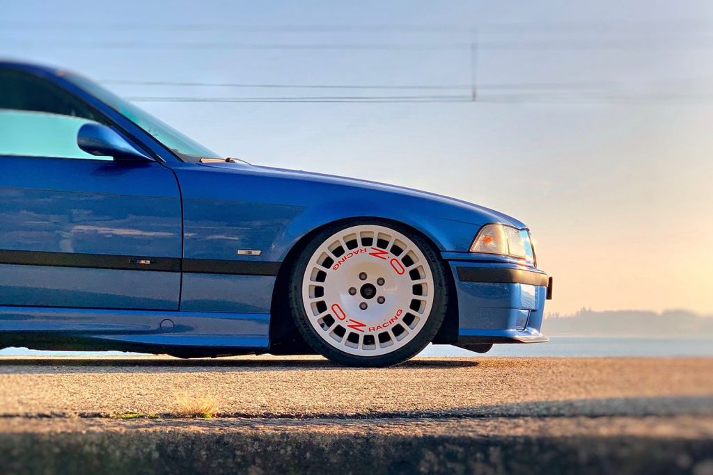 A set of rally-style O.Z wheels on a blue E36 BMW