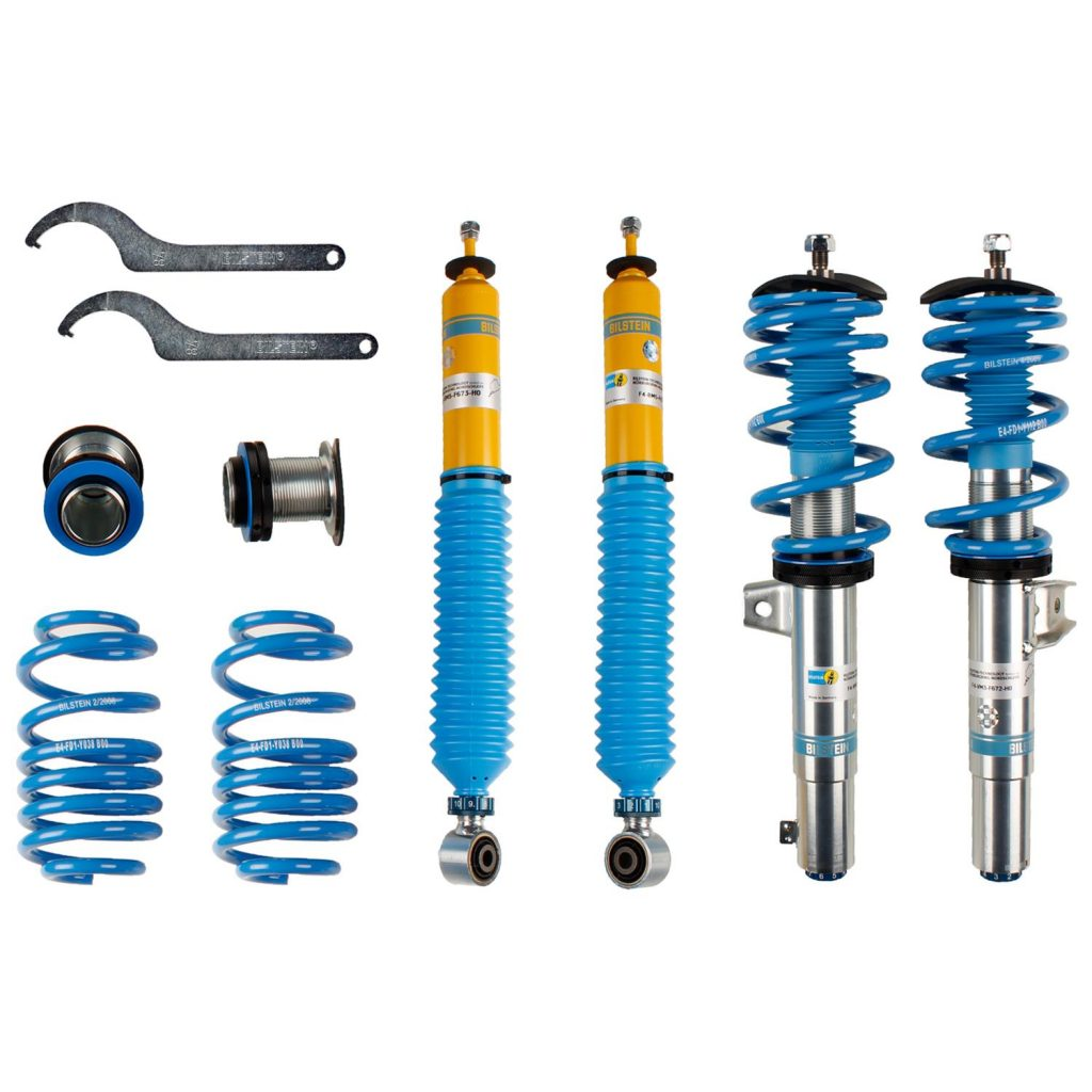 A set of blue and yellow Bilstein coilovers