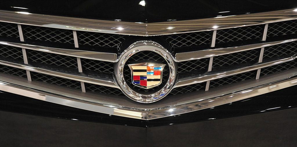 A Cadillac emblem on the grille of a luxury car