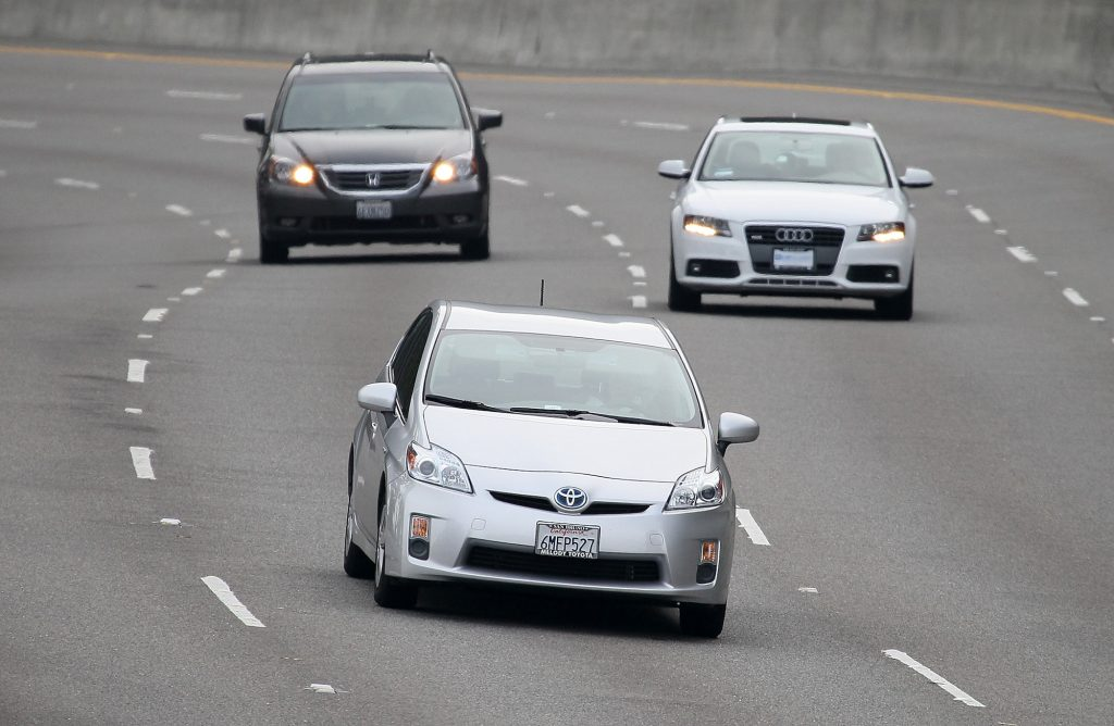 A Toyota Prius drives along Highway 101 on November 30, 2010, in Sausalito, California. Toyota issued a recall for 650,000 Prius hybrids to repair cooling pumps that could fail and cause the vehicle to overheat and lose power.