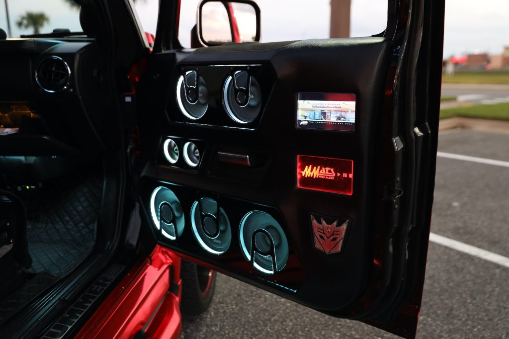 LEDs surround the speakers in the door of a custom Hummer.
