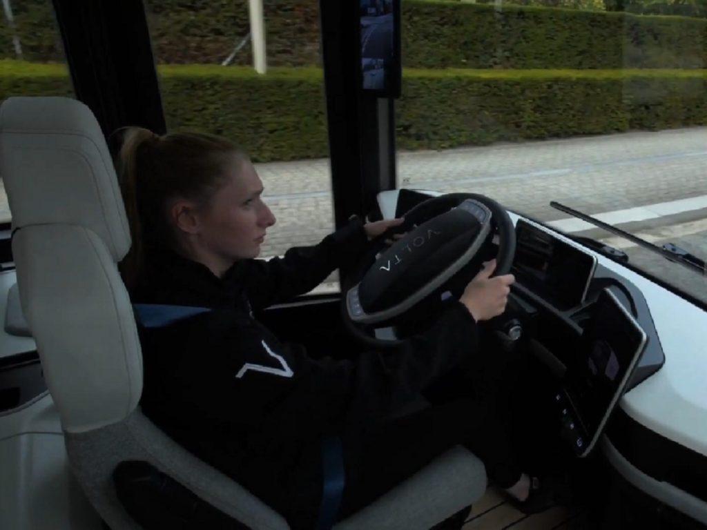 A driver navigates a Volta Zero bus through a city.