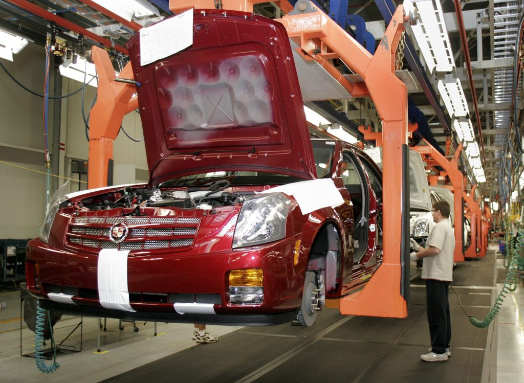 A General Motors worker assembles a new Cadillac on the assembly line at the GM Lansing Grand River Plant.