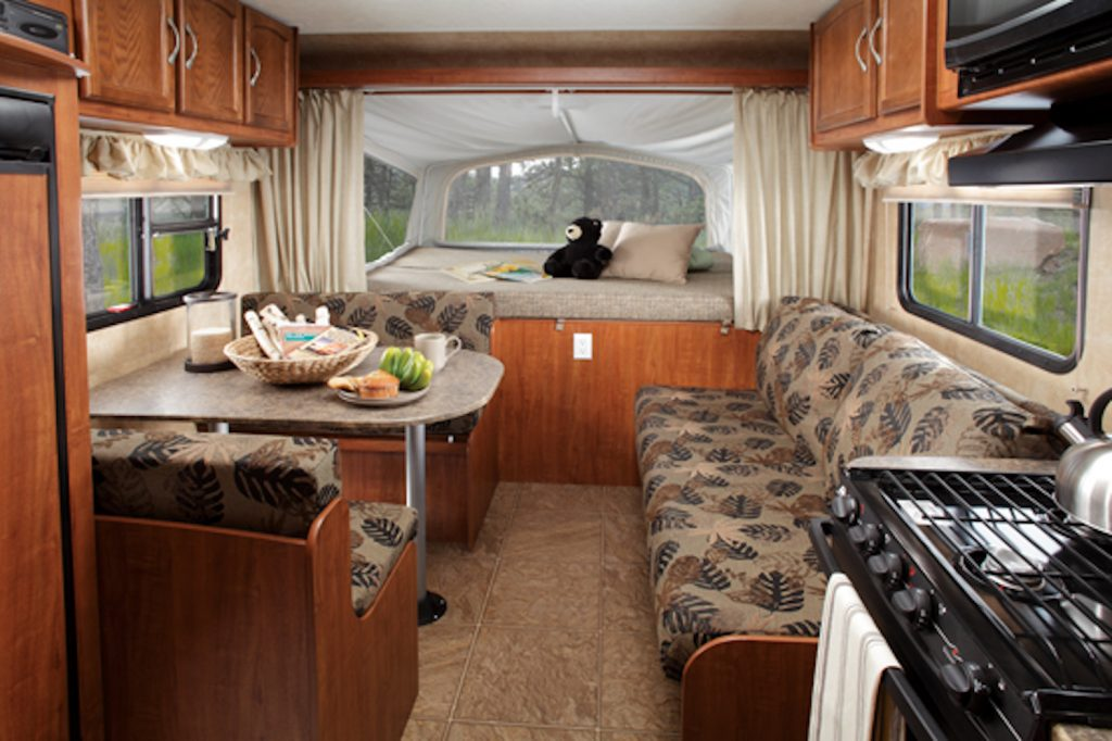 The interior living area inside of a 2011 Jayco Jay Feather Sport shows an example fo a used RV for under $5,000.