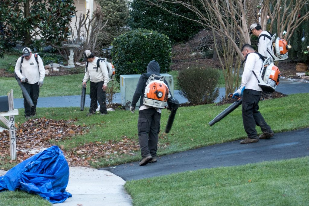 Multiple backpack leaf blowers in action in Fairfax Station, Virginia