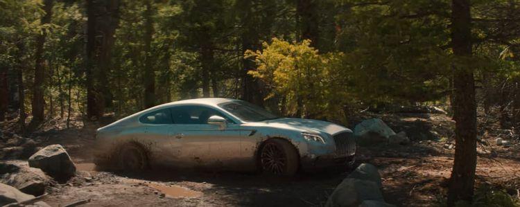 GMC commercial still of stranded supercar