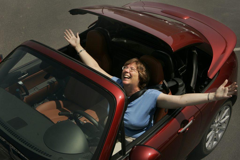 Marna Wood loves her new 2007 Mazda Miata MX–5 hardtop convertible.
