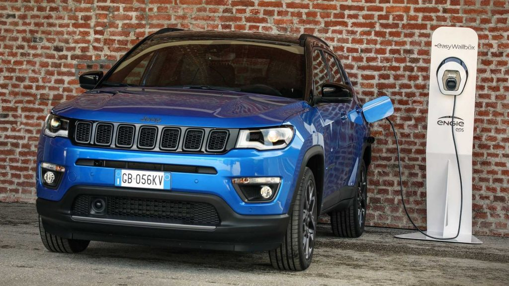 A blue 2021 Jeep Compass 4xe plugged in to a charger