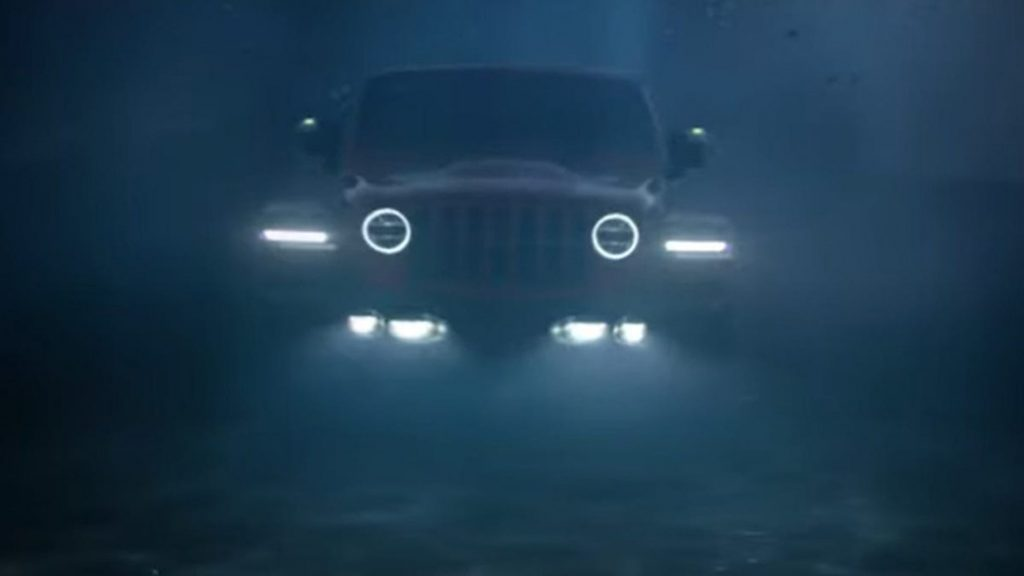 An image of a Jeep Wrangler underwater.