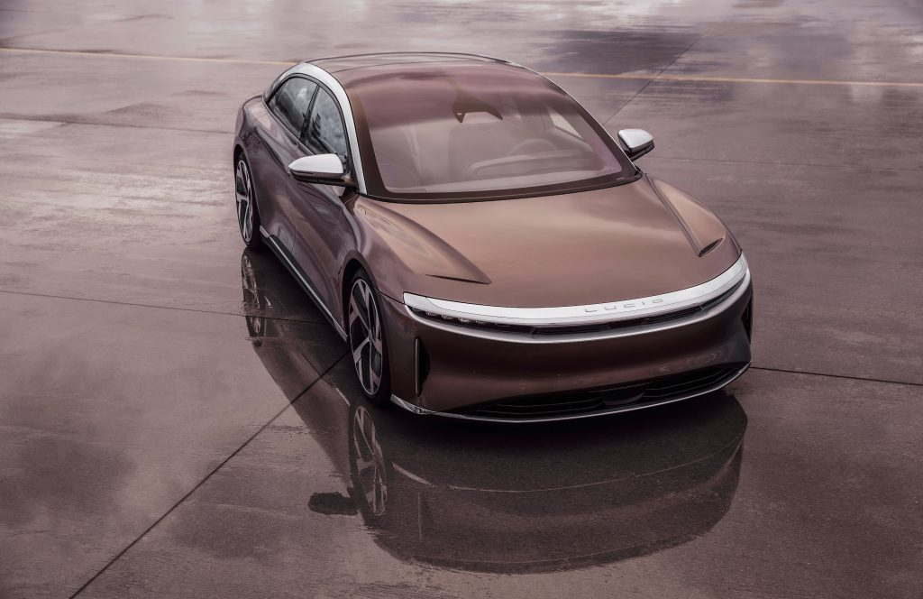 A brown Lucid Air parked on concrete