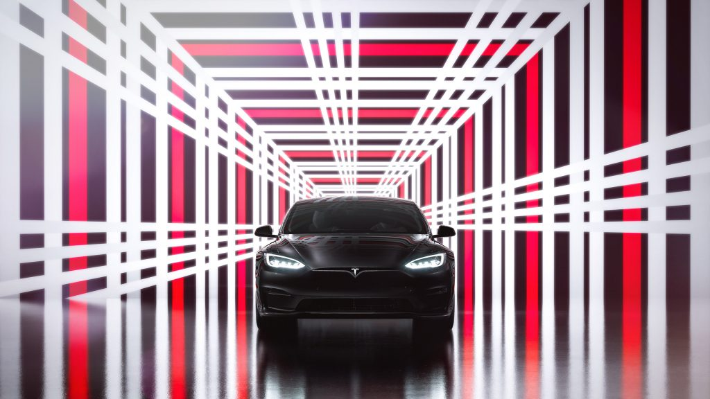 The Tesla Model S Plaid sits in a photo box with the Plaid logo surrounding it