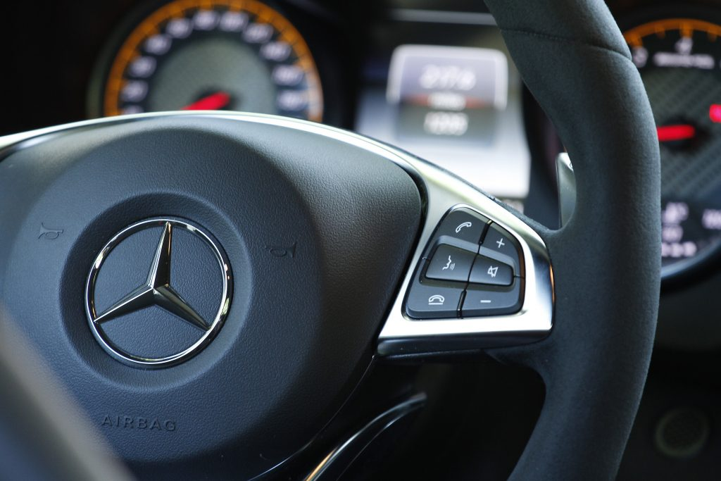 A foam-covered steering wheel and paddle shifters show its race inspiration in the 2016 Mercedes-AMG GT S.