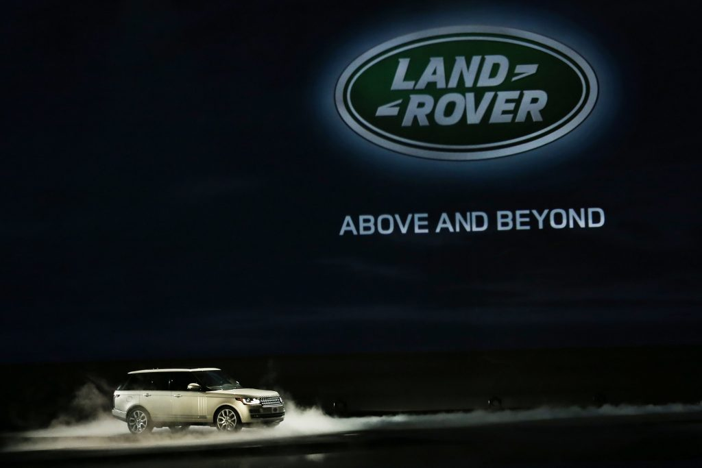 A land rover range rover on display