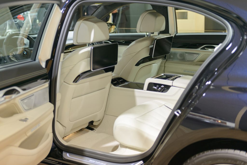 The interior is on a BMW 7 Series luxury limousine car.