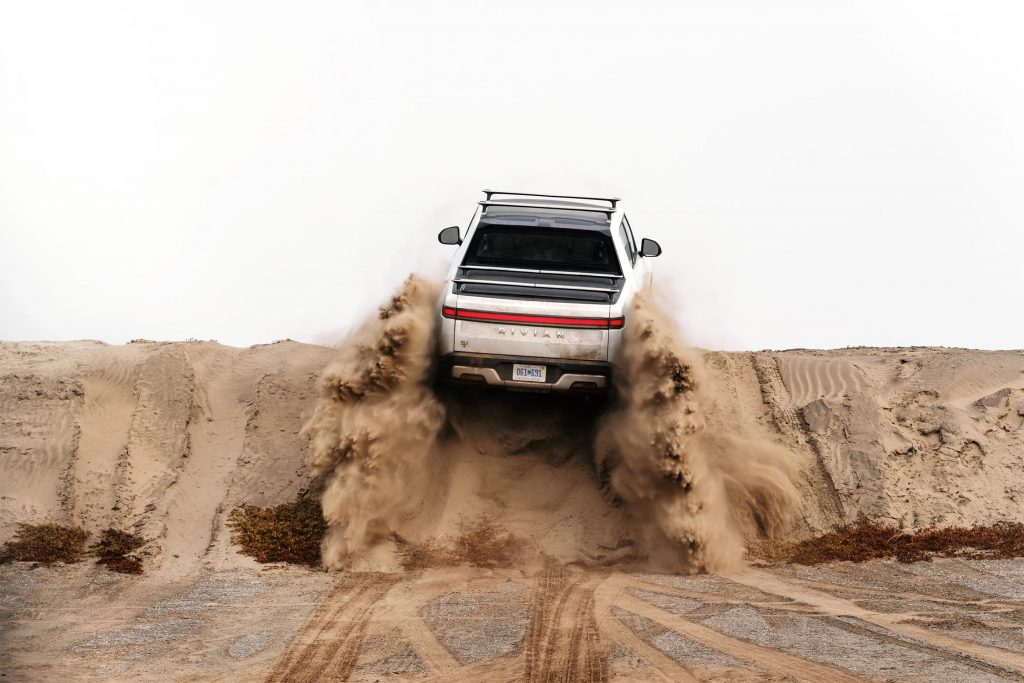 Rivian R1T climbing a sandy hill as they patent a new Star Wars inspired K-turn feature