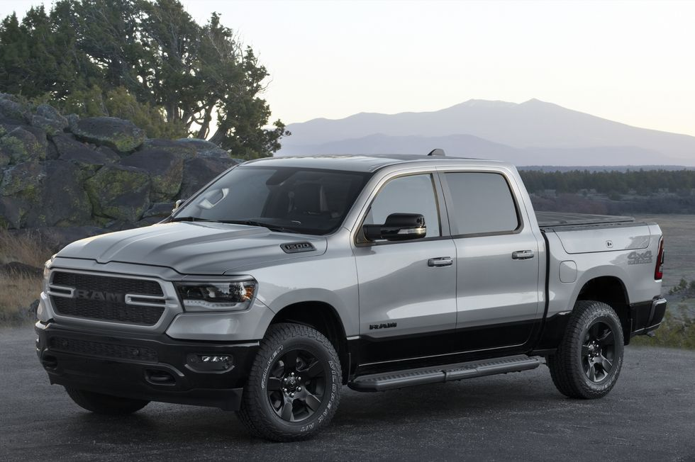 A grey 2022 Ram 1500 BackCountry Edition parked in front of a mountain view