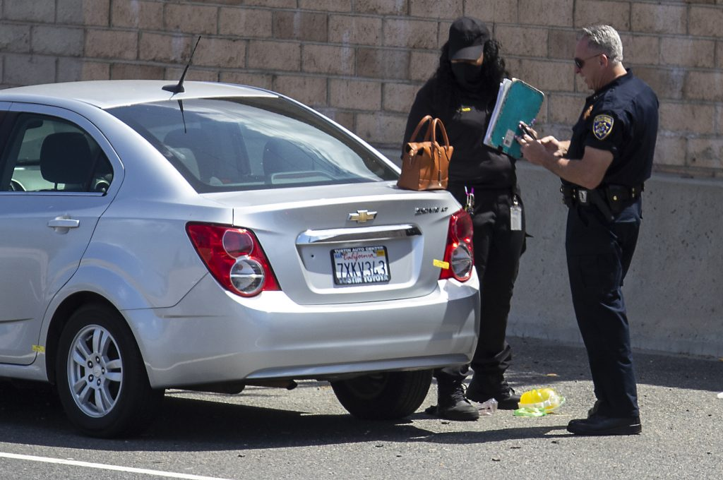 A California Highway Patrol officer and a crime scene investigator at the scene of a deadly road rage incident on May 21, 2021