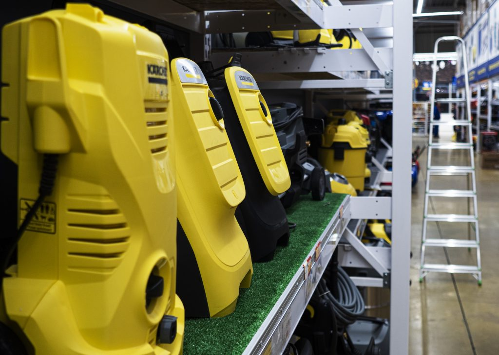 Yellow shop vacs on a shelf in a store