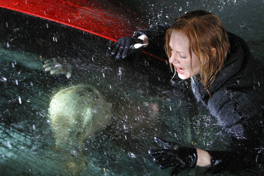 Catherine (Marg Helgenberger) attempts to rescue Lindsay (Madison McReynolds), trapped inside a sinking car on 'CSI'