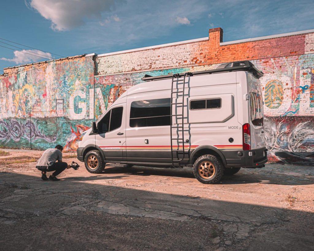 Storyteller 4x4 camper van parked in front of graffiti