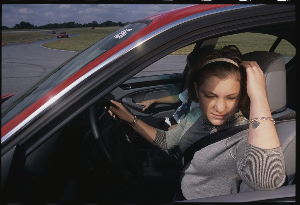 Student drivers at a BMW driving school for teenagers.