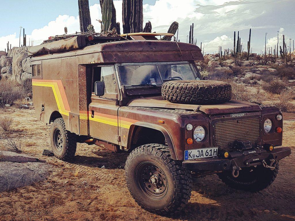 Vintage Land Rover overland camper parked in the desert