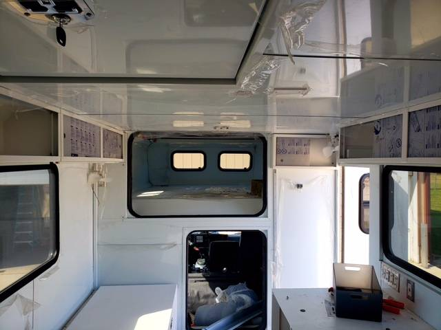 The interior of the modified Isuzu overland camper featuring several beds and safes