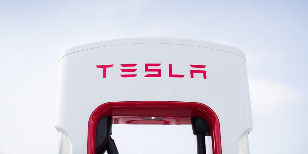 A Tesla Supercharger against a sky.