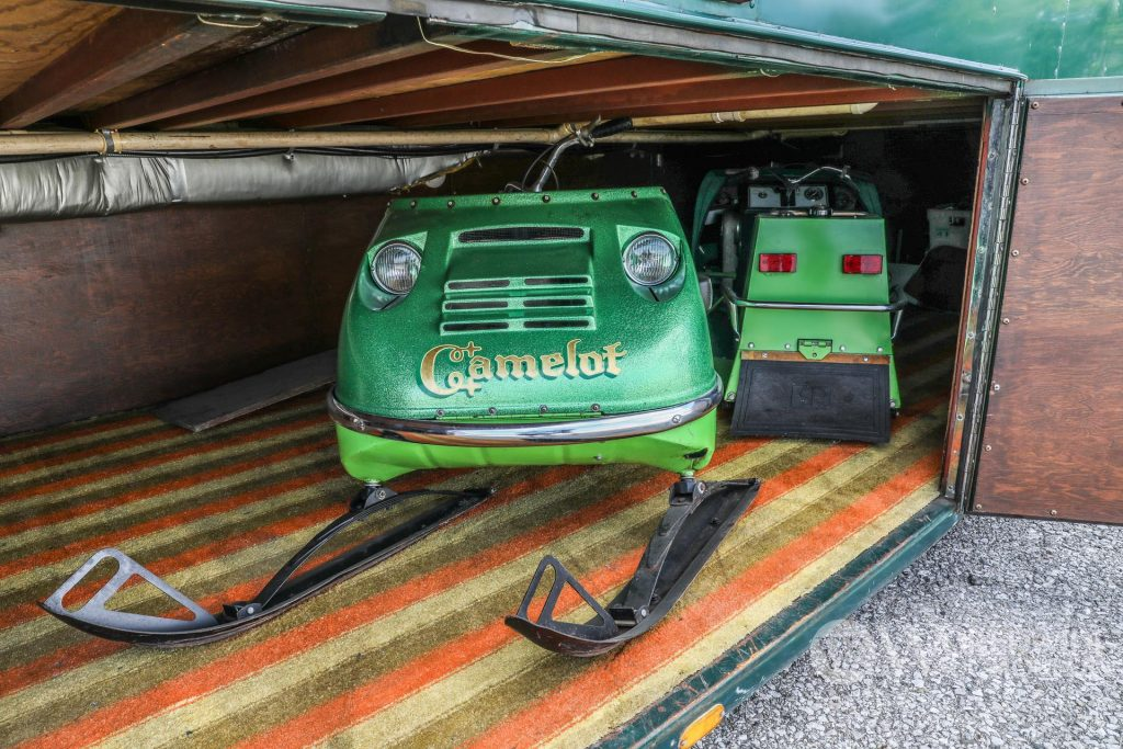 1974 Camelot Cruiser basement with two vintage snowmobiles