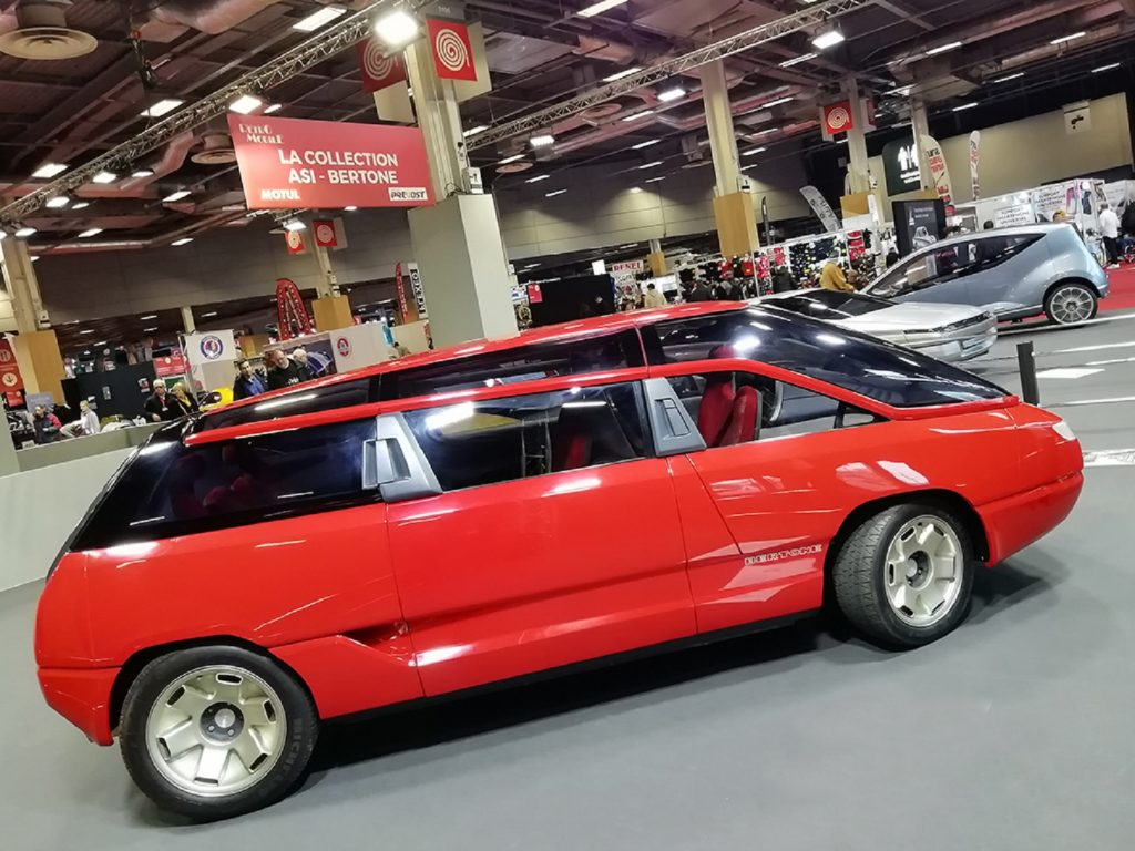The side view of the red 1988 Bertone Genesis at Retromobile 2020