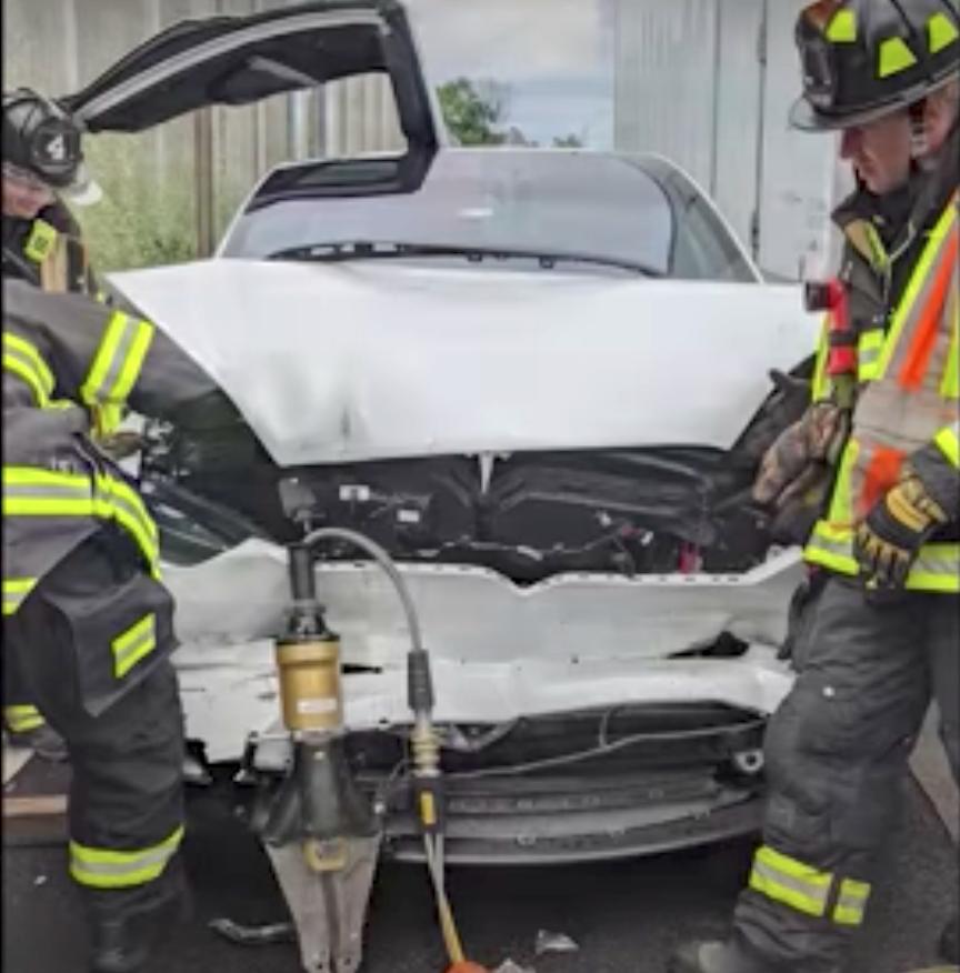 2 crash white Tesla Model X.