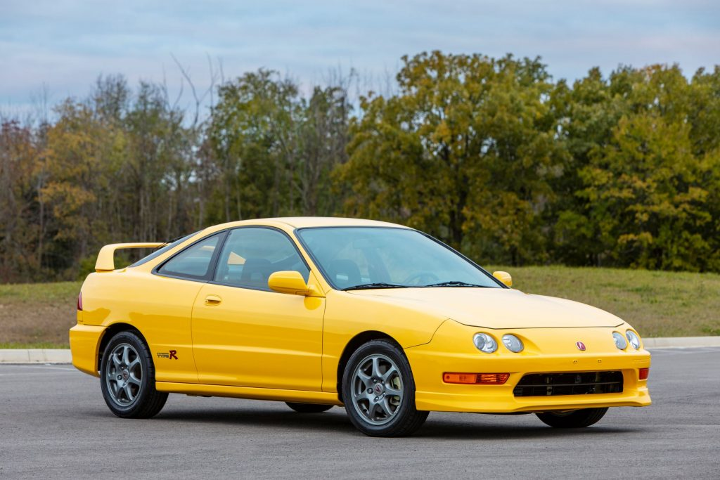 A yellow 2001 Acura Integra Type R on a racetrack