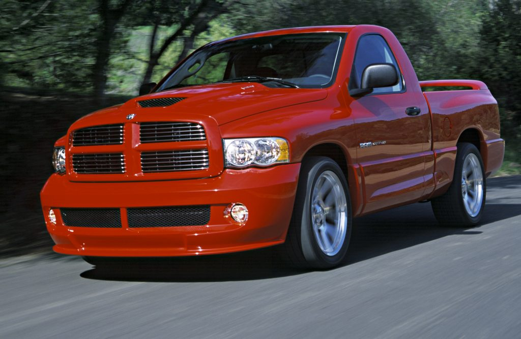 A red 2004 Dodge Ram SRT-10 driving on a racetrack