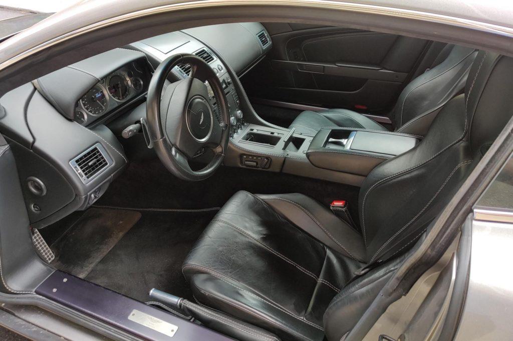 The black-leather interior of a 2008 Aston Martin V8 Vantage