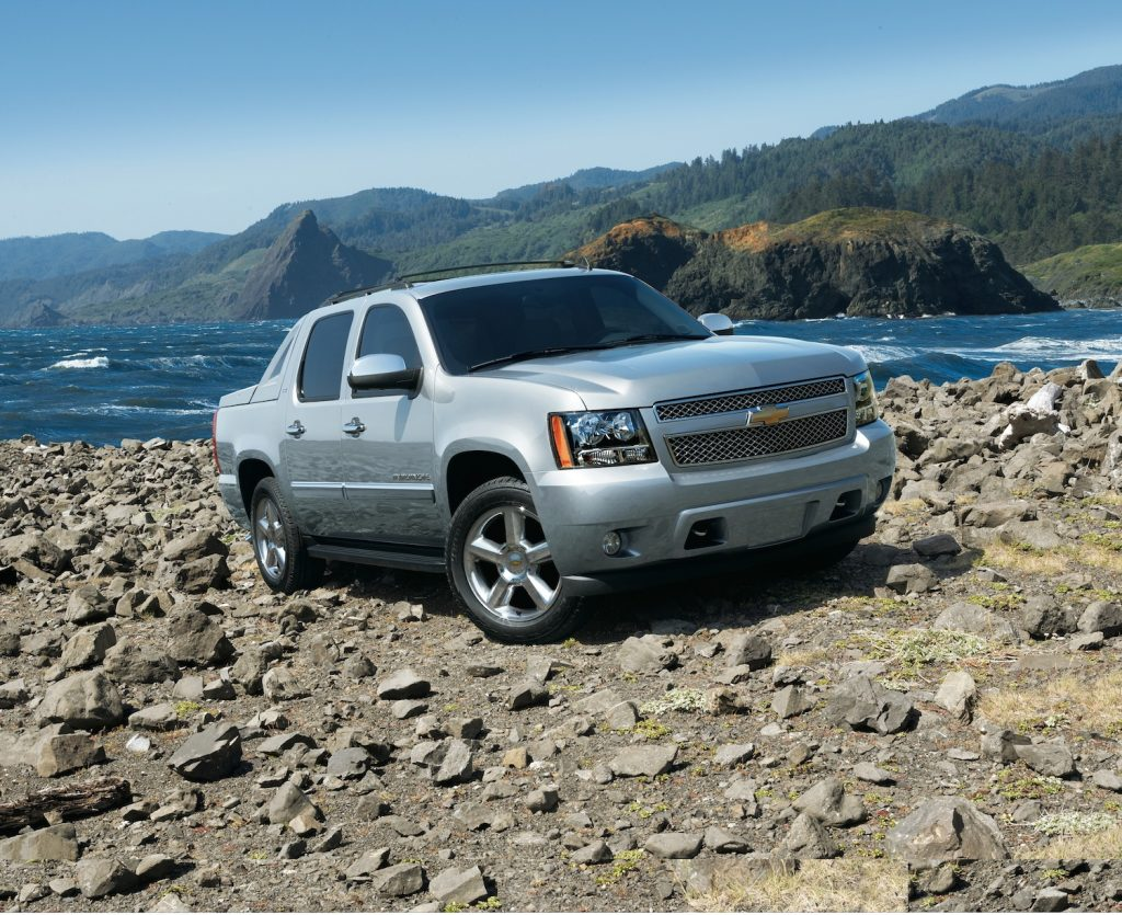 The 2012 Chevrolet Avalanche off-roading over rocks