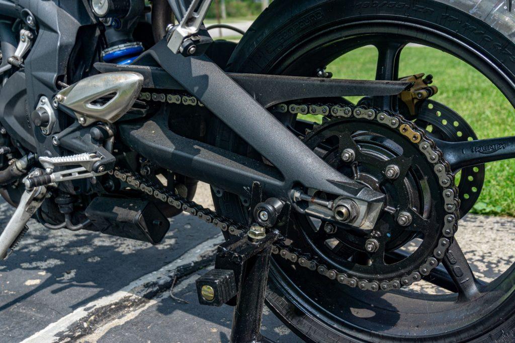 A 2012 Triumph Street Triple R with a dirty chain