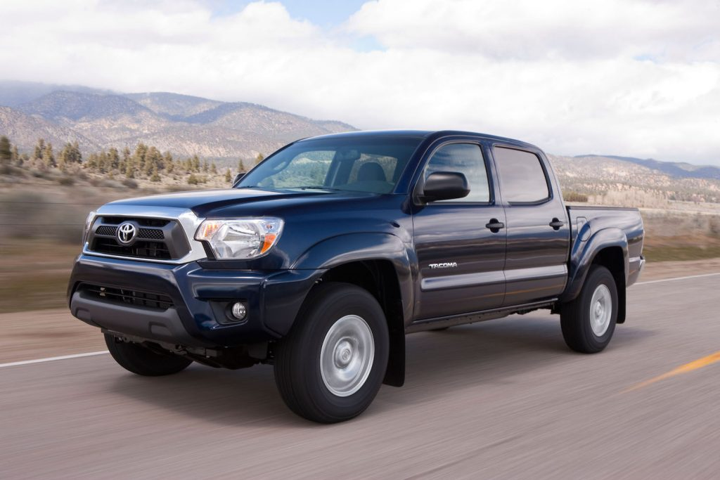 A 2015 Toyota Tacoma driving through the wilderness, the 2015 Toyota Tacoma is one of the best used trucks - one of the best used pick up trucks under $20,000