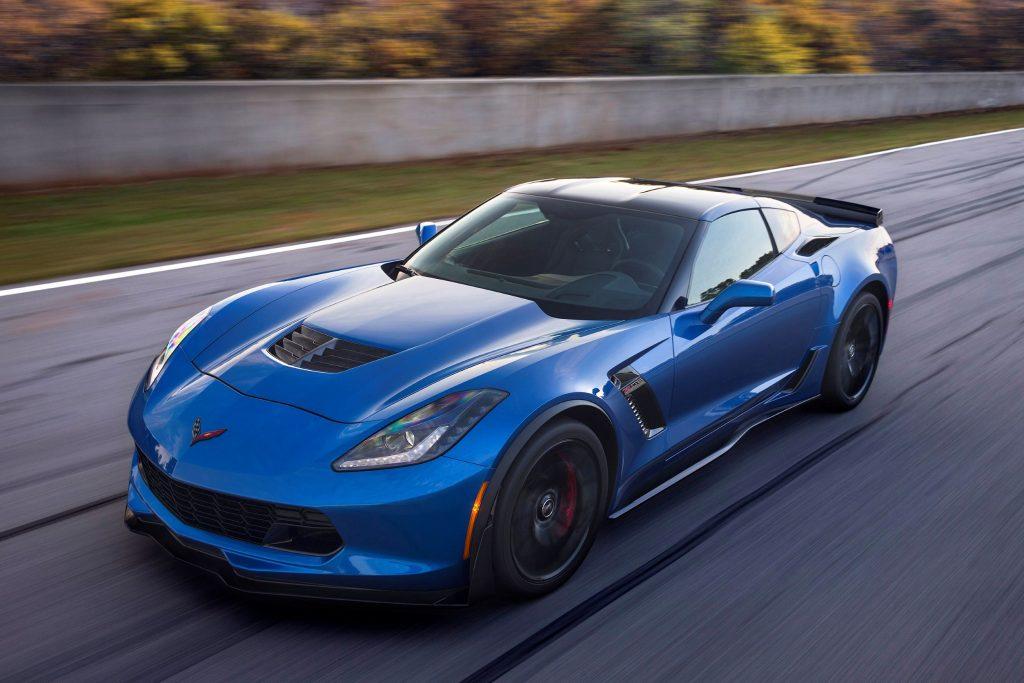 A blue 2016 C7 Chevrolet Corvette Z06 speeds down a racetrack