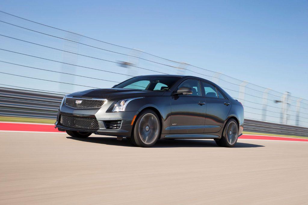 A gray 2016 Cadillac ATS-V Sedan goes around a racetrack