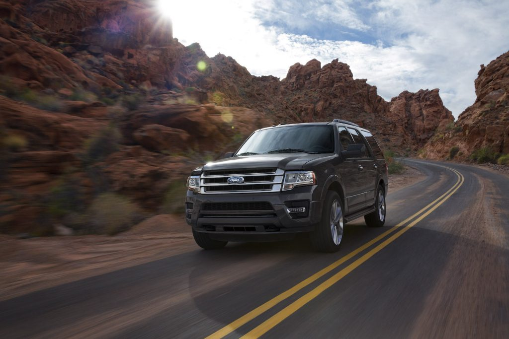 A 2016 Ford Expedition driving around a bend, the 2016 Ford Expedition is one of the worst used SUVs with paint problems