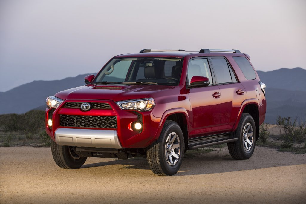 A red 2016 Toyota 4Runner parked at dusk, the 2016 Toyota 4Runner is one of the most reliable 5-year-old used midsize SUVs