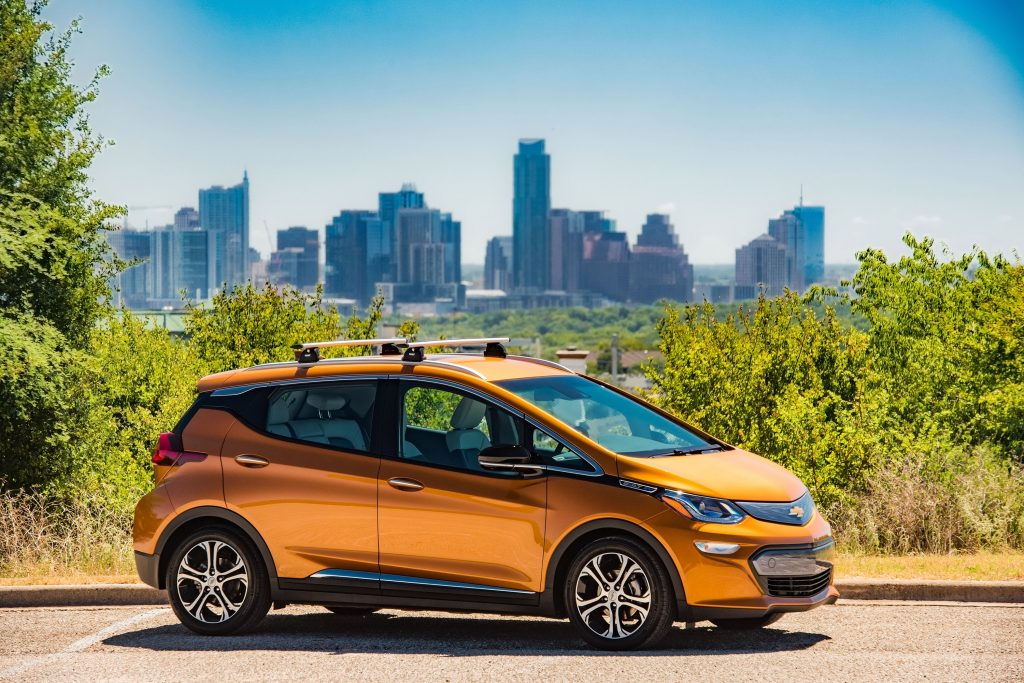 The Chevy Bolt EV hatchback with Austin, Texas in the background