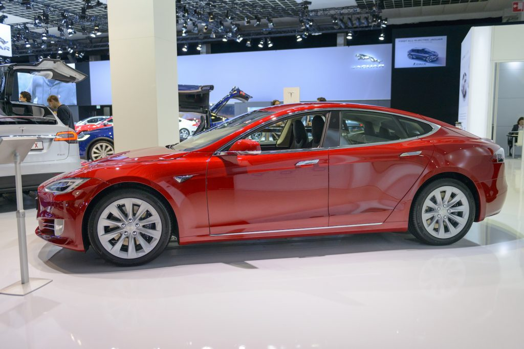 A red 2017 Tesla Model S at a car show, the Model S is one of the best used EVs