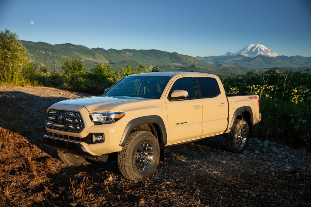 A tan 2017 Toyota Tacoma parked in front of mountains, the 2017 Toyota Tacoma is one of the best used trucks under $30K